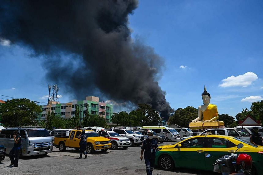 Smoke seen billowing from a plastics factory after an explosion and fire, in Bangkok, Thailand, on July 5, 2021.