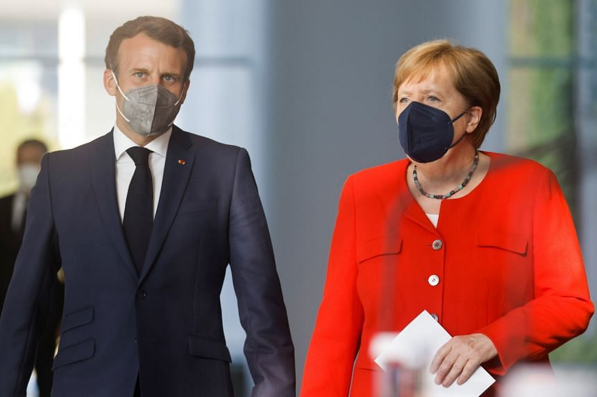 French President Emmanuel Macron and German Chancellor Angela Merkel spoke with Chinese President Xi Jinping in a video conference on July 5, 2021.