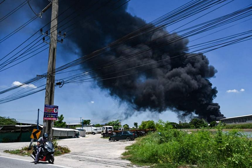 Smoke seen rising from the site of an explosion and fire at a plastics factory in Bangkok on July 5, 2021.