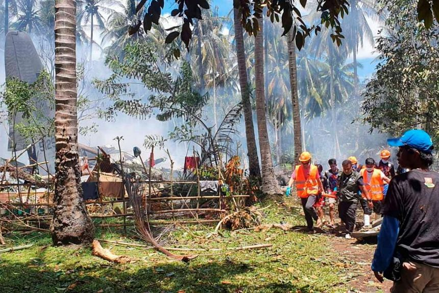 First responders at the Philippine Air Force plane's crash site in Patikul in Sulu province on July 4.