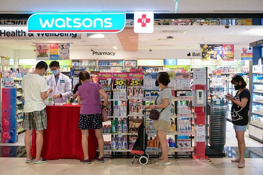 People waiting to collect their oximeters at a Watsons outlet in Junction 8 on July 5, 2021.