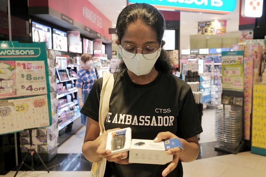 Student Sahana Rajendrakumar, 16, collecting her oximeter at Watsons in Clementi Mall on July 5, 2021. ST PHOTO: GAVIN FOO