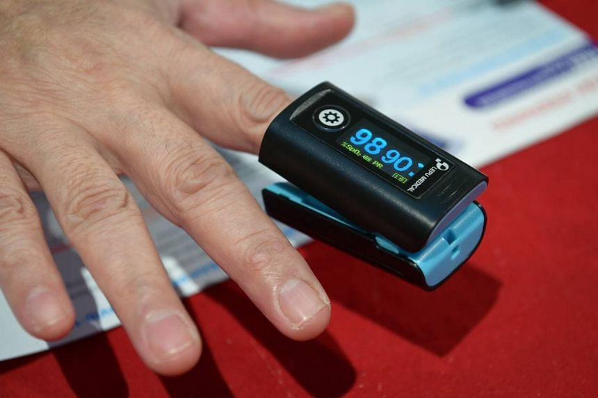 The device, given out by Temasek Foundation, checks the oxygen level in the blood to detect early signs of a deterioration in health.