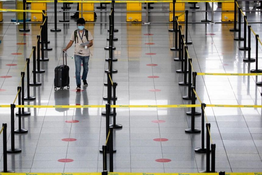 A passenger wearing a face mask and face shield for protection against the coronavirus disease walks towards a counter in the Ninoy Aquino International Airport in Paranaque, Metro Manila, Philippines on January 14, 2021.