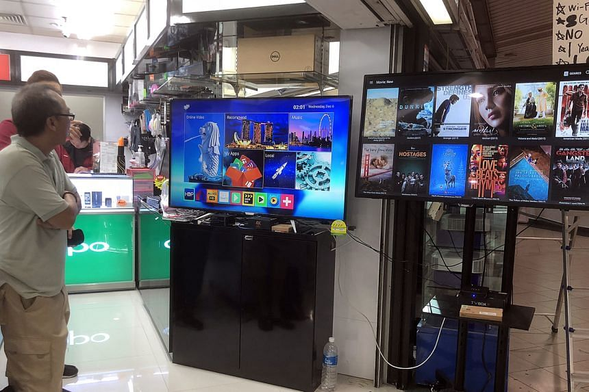 Android TV boxes for sale at Sim Lim Square in 2017. Selling set-top boxes offering pirated streamed shows will soon be outlawed.