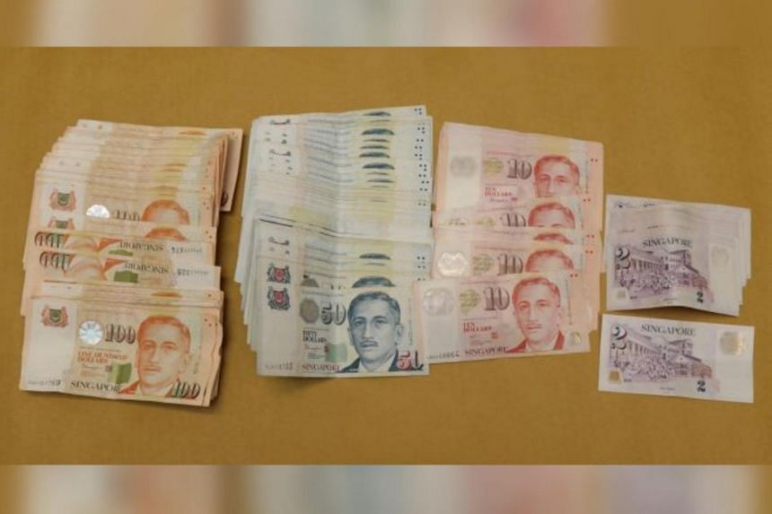 Part of the $57,929 in cash seized from a residential unit in the vicinity of Tampines Street 83, on July 5, 2021.