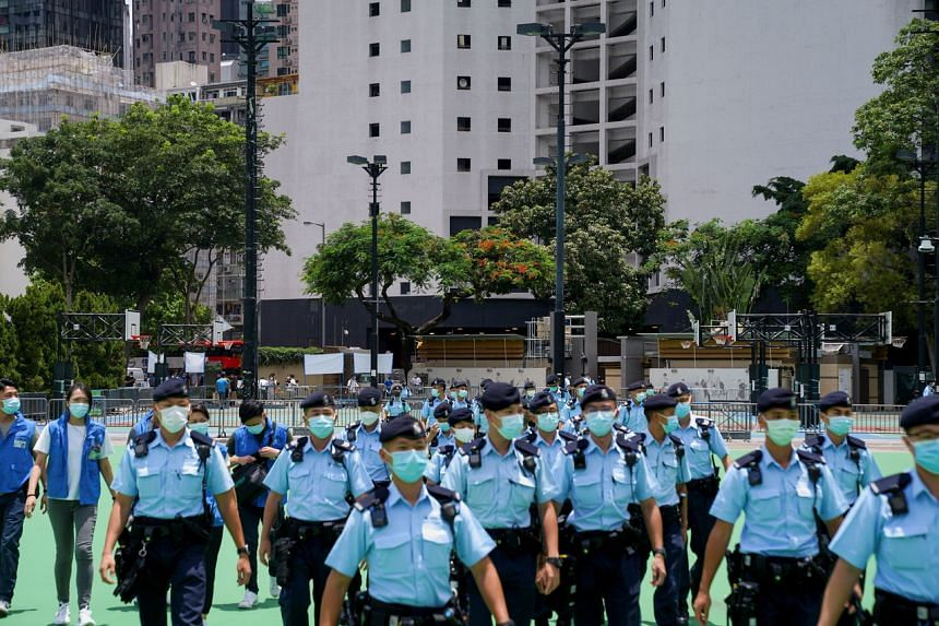 Police officers in Victoria Park in Hong Kong on July 1, 2021.