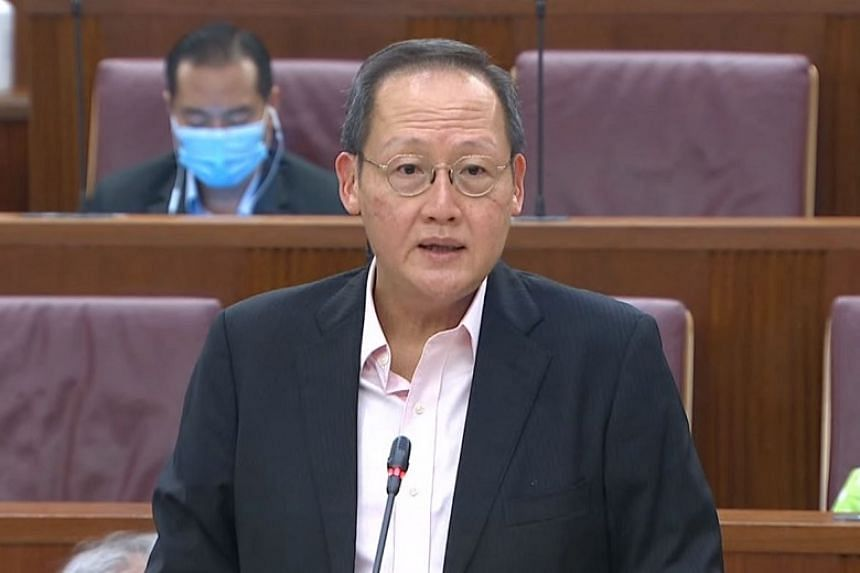 Manpower Minister Tan See Leng presenting a statement on free trade agreements and foreign workers.
