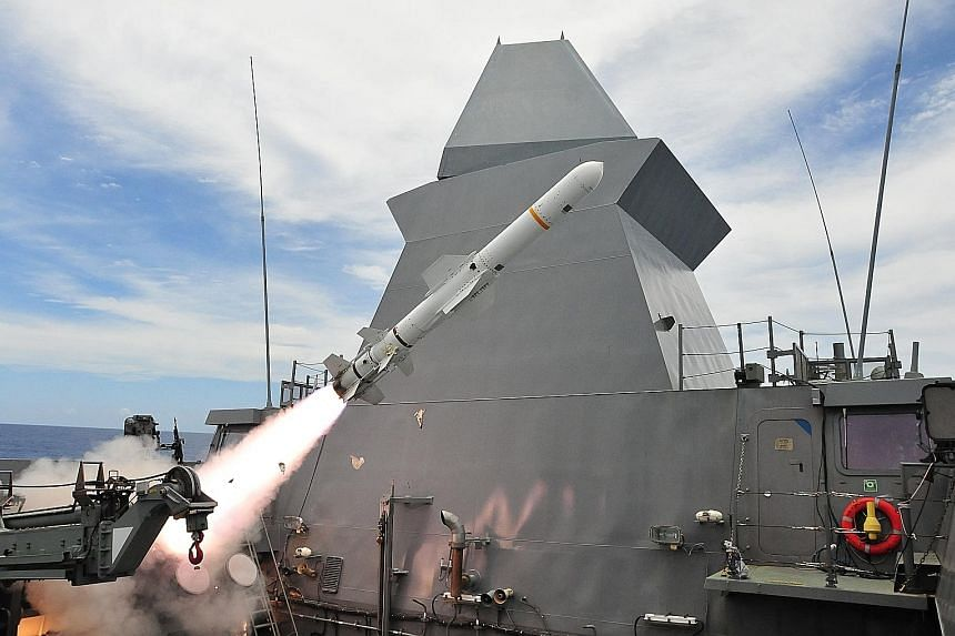 The Republic of Singapore Navy frigate RSS Tenacious firing a harpoon anti-ship missile during a coordinated strike with RSS Stalwart and RSAF fighters, in the waters off Guam during Exercise Pacific Griffin. PHOTO: MINDEF