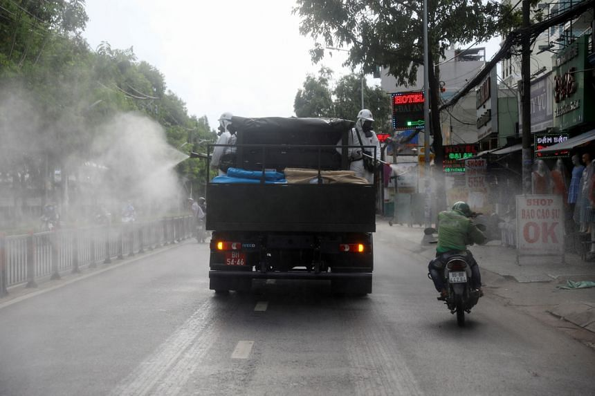 A truck sprays disinfectant amid the Covid-19 outbreak in Ho Chi Minh city, on June 1, 2021.