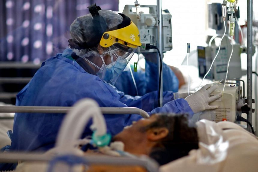 A health worker checks on a patient suffering from Covid-19 at a hospital in Argentina.