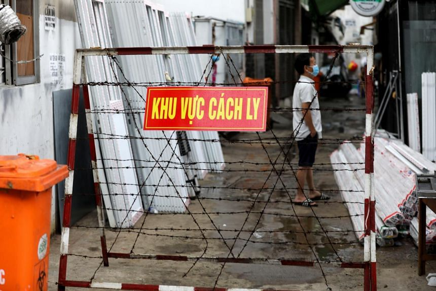 A warning sign is seen outside an area slapped with a quarantine order in Ho Chi Minh City, on June 1, 2021.