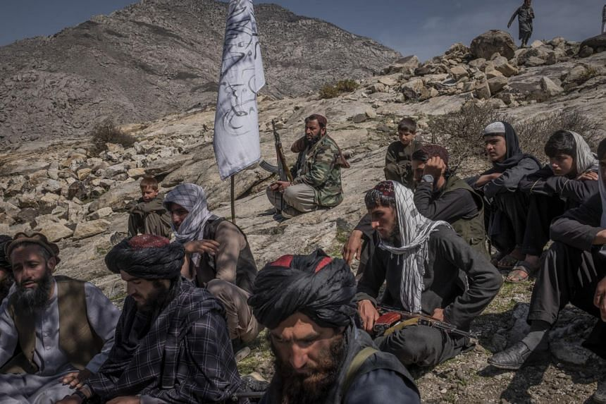 A photo from March 13, 2020, shows members of the Taleban in Laghman province, eastern Afghanistan.