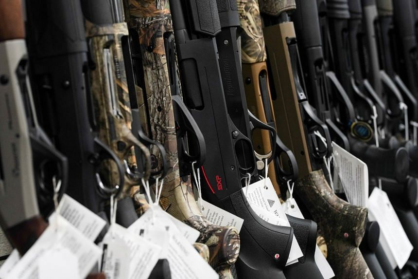 Rifles are displayed for sale at a firearms store in the US state of California.