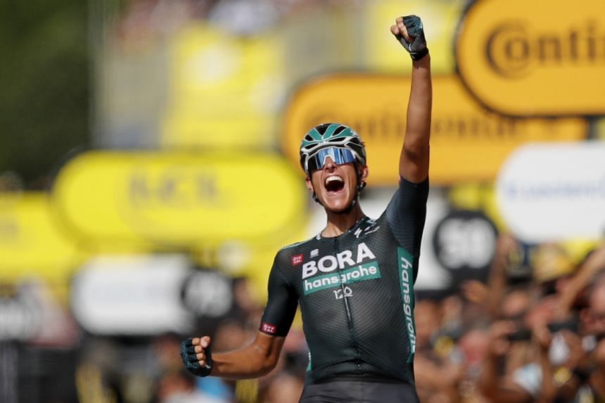 Bora–Hansgrohe rider Nils Politt of Germany celebrates as he crosses the line to win stage 12.