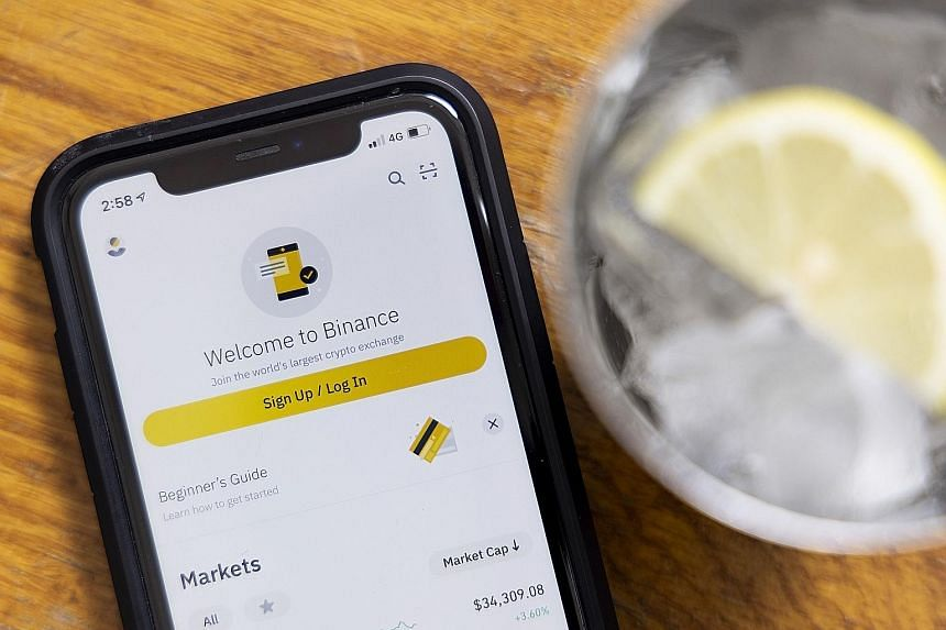 Above: The Binance cryptocurrency exchange trading app. Right: Binance has faced heavy scrutiny from global regulators in recent months. Notably, Britain's financial watchdog has barred the company from carrying out regulated activities.