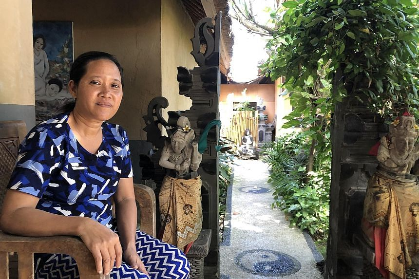Ms Diaz at Watercress restaurant. Before the second lockdown, the bistro had seen a partial recovery. Ms Wayan Sumiati at Devira Massage. Clientele has thinned out dramatically and she is unsure how she can afford to renew the lease. An empty street
