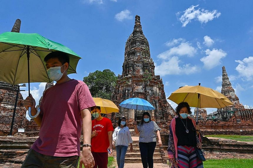 Visitors at the 17th-century Wat Chaiwatthanaram temple complex in Ayutthaya, north of Bangkok, last month. Thailand's small and medium-sized enterprises, many of them concentrated in the tourism industry, have been hit especially hard since the coun