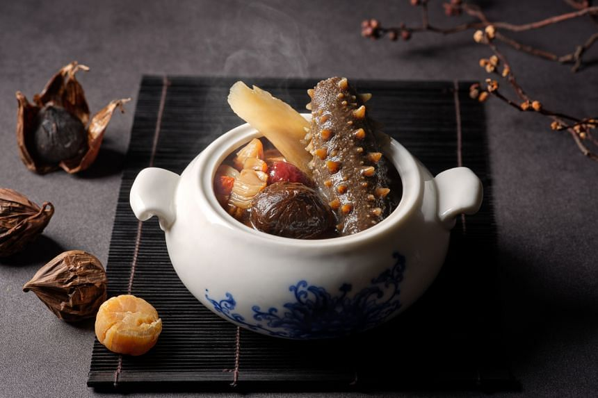 The full-bodied, double-boiled Japanese black garlic Kanto sea cucumber soup is packed with ingredients, flavour and natural sweetness.