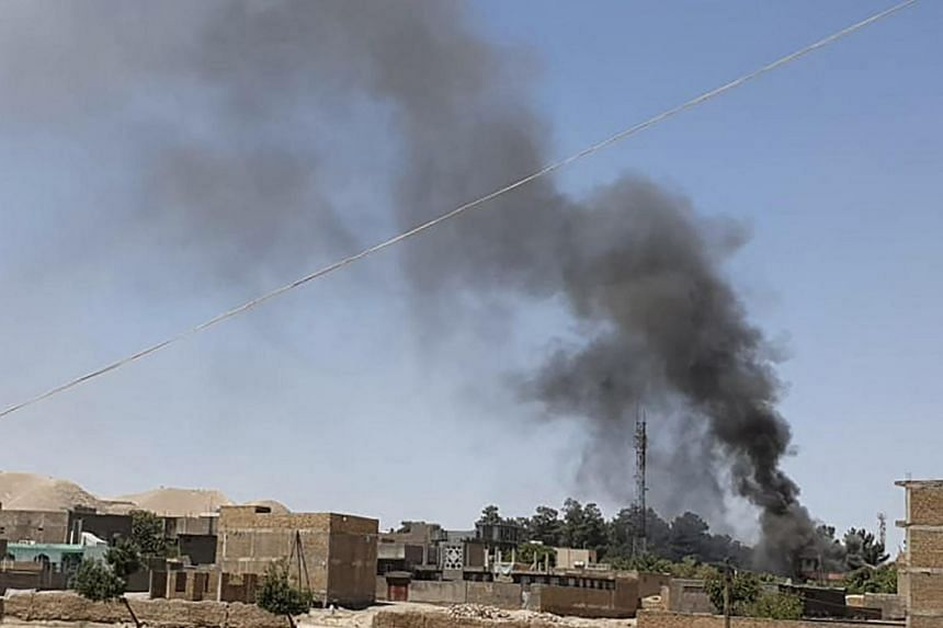 Smoke rising from houses amid fighting between Afghan forces and Taleban fighters in Qala-i-Naw on July 7.
