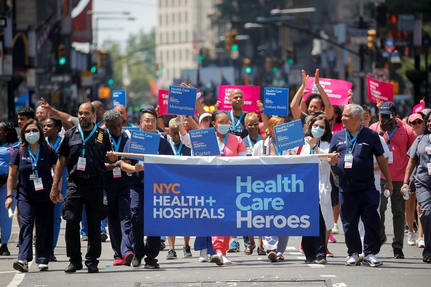 """Hundreds of essential workers marched down the southern stretch of Broadway in Manhattan known as the """"Canyon of Heroes""""."""