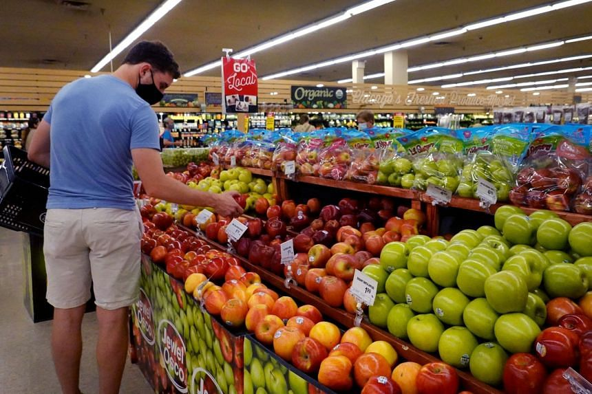 Customers shop for produce at a supermarket on June 10, 2021, in Chicago, Illinois.