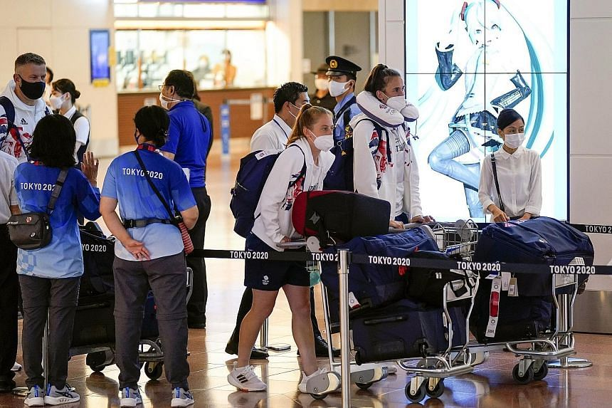 Britain's Olympic Team members arriving at Tokyo International Airport in Haneda yesterday. The absence of crowds at Tokyo 2020 will likely further strain the Games' budget, with ticket revenues expected to dwindle to close to zero.