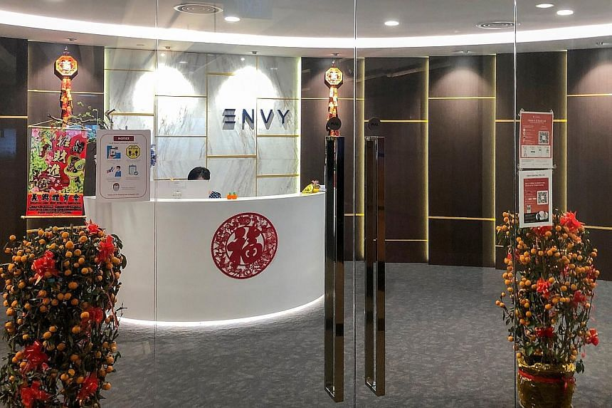 Ng Yu Zhi, ex-managing director of Envy Global Trading (right) and Envy Asset Management, faces 31 charges, most of them alleging cheating.