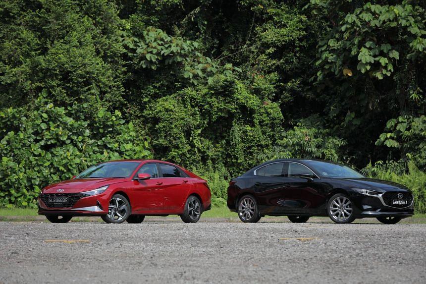 Hyundai Avante (left) and Mazda 3.