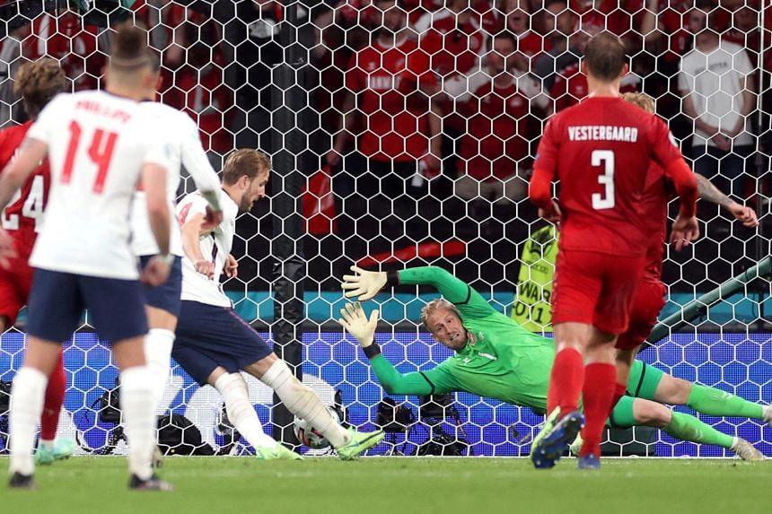 Kasper Schmeichel saved the spot-kick but Harry Kane scored from the rebound.