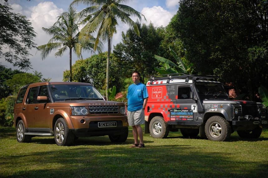 Mr Larry Leong pictured with his Landrovers on June 24, 2021.