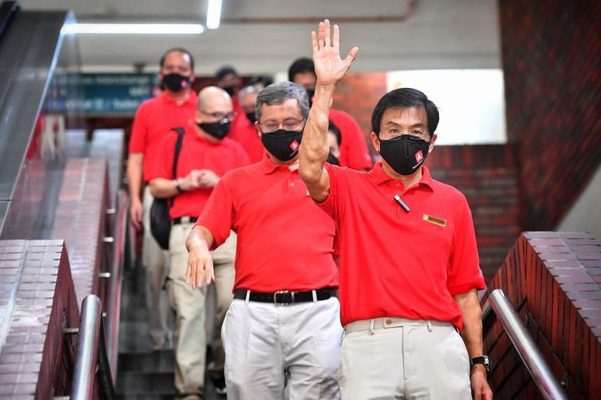 Singapore Democratic Party candidates, led by Dr Chee Soon Juan, on the campaign trail in Bukit Batok during the general election on July 8, 2020.