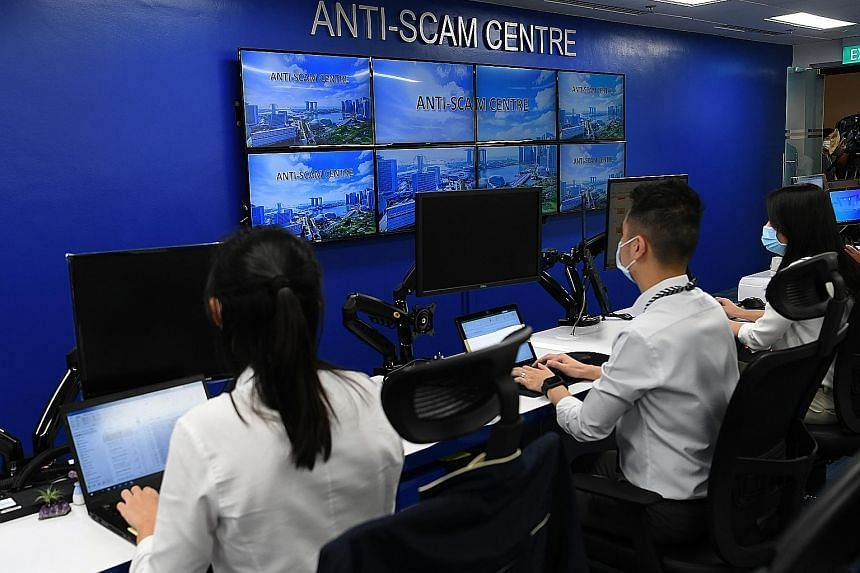 Officers at the Singapore Police Force's Anti-Scam Centre.