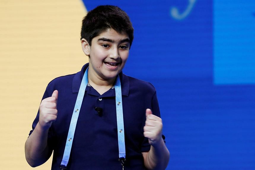 Dhroov Bharatia reacts after correctly spelling a word during the 2021 Scripps National Spelling Bee Finals in Florida on July 8, 2021.