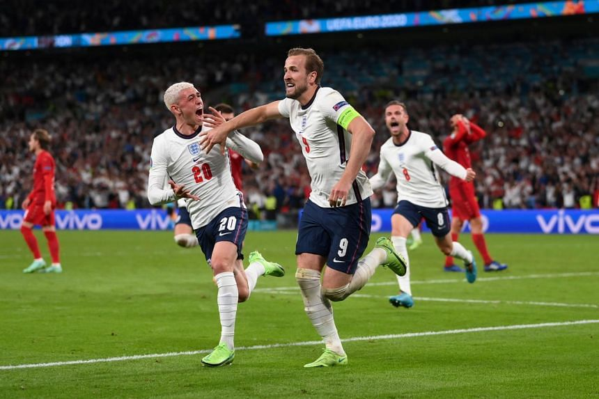 England's Harry Kane celebrates scoring their second goal with Phil Foden on July 7.