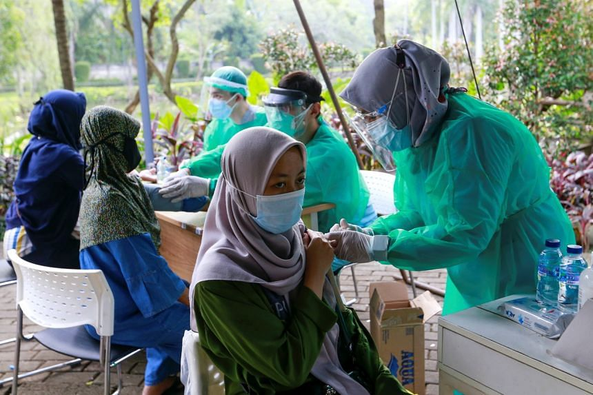 A woman receiving a Covid-19 vaccine dose at a mobile vaccination van in Jakarta on July 8, 2021.