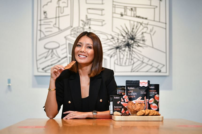 Co-Founder & CEO of Baken Pte Ltd Rachel Carrasco with Baken products like Bacon Jam, Bacon Cookies and Bacon Brittle.