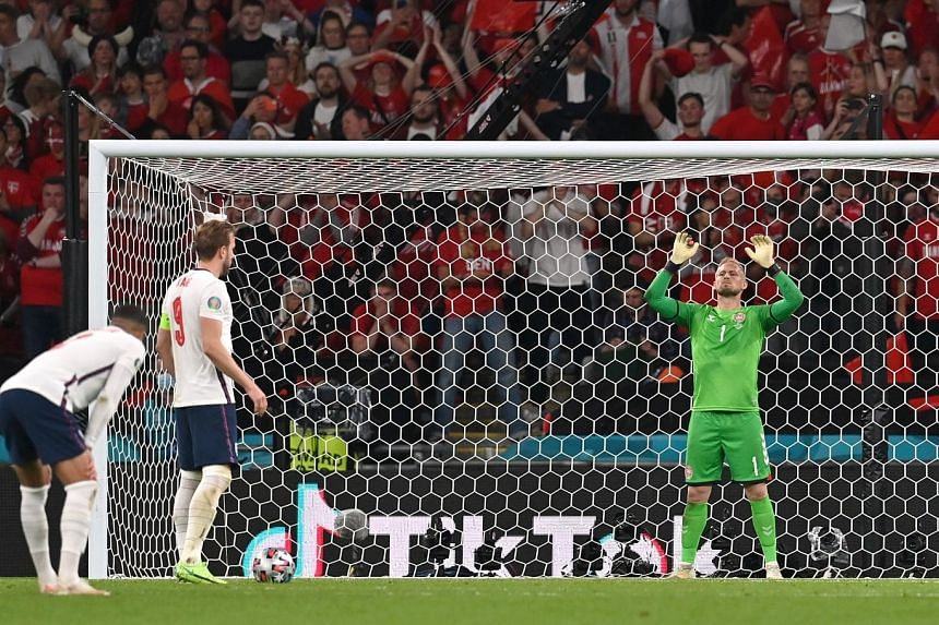 Harry Kane about to take England's extra-time penalty, which Denmark custodian Kasper Schmeichel saved before Kane scored from the rebound for the winning goal. Schmeichel had a laser pointed at his right side just before the spot kick.