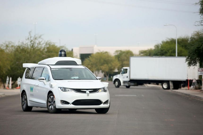 A 2018 photo of a Waymo Chrysler Pacifica Hybrid self-driving vehicle in Arizona. Waymo became an independent company in 2017 under Google parent Alphabet, launched an autonomous ride-hailing service in Phoenix in 2018 and last year began testing sel