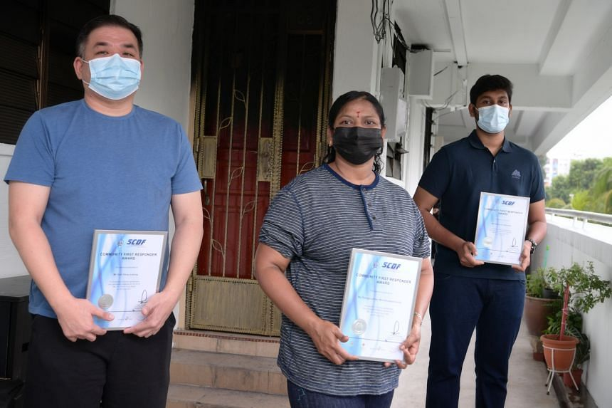 (From left) Mr Soh Shao Leong, Madam Ranganathan Mouttoulatchoumy and Mr Baskaran Sabarish went separately into the flat and helped to get the neighbour out.