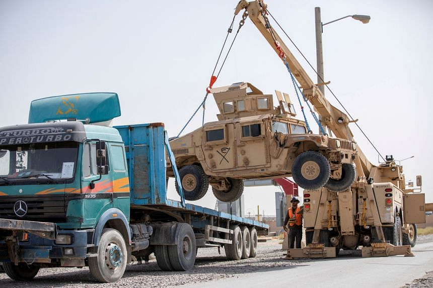 A US military vehicle being loaded onto a truck in Kandahar, Afghanistan, last year.