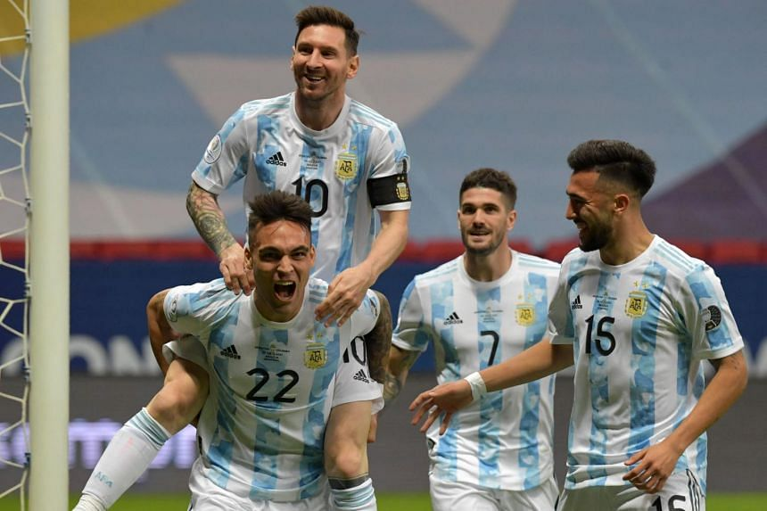 Argentina's players celebrating during their Copa America football match at the Mane Garrincha Stadium in Brasilia, on July 6, 2021.