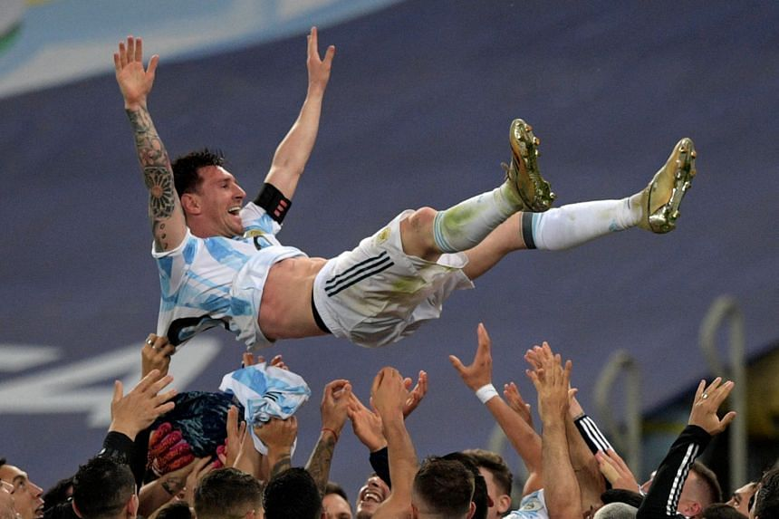 Argentina's Lionel Messi is thrown into the air by teammates after winning the Conmebol 2021 Copa America final against Brazil, on July 10, 2021.