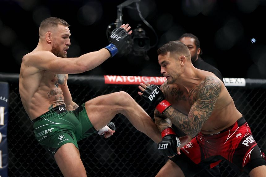 Conor McGregor (left) attempts a kick against Dustin Poirier in the first round in their lightweight bout in Las Vegas on July 10, 2021.