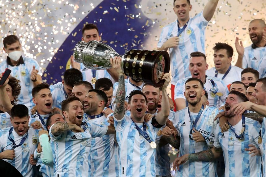 Argentina players celebrate with the trophy after winning the Copa America final against Brazil in Rio de Janeiro on July 10, 2021.