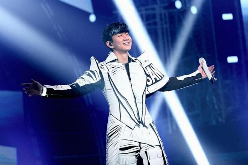 JJ Lin opened the show in a snazzy futuristic white outfit.
