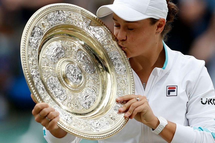 Australia's Ashleigh Barty kisses the trophy after winning her women's singles match against the Czech Republic's Karolina Pliskova.