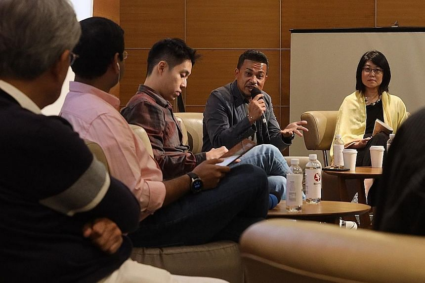 """The panellists at the three-hour session on """"Race and Us"""" are (from right): Dr Teng Siao See, assistant dean of strategic engagement at the National Institute of Education; Mr Bernard Menon, executive director of the Migrant Workers' Centre; Adam Smi"""