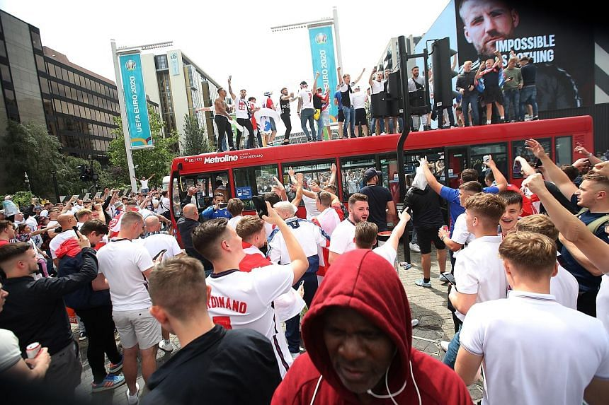 Fans outside Wembley stadium in London yesterday, ahead of the Euro 2020 football championship final between England and Italy. The authorities in Britain fear that large gatherings to watch England's first appearance in a major football final in mor