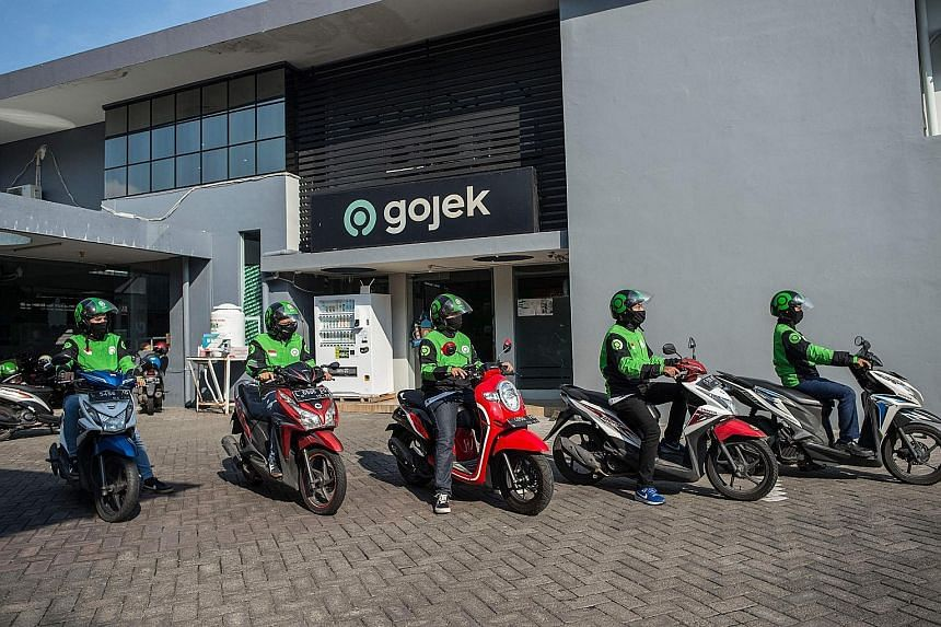 Start-up giants GoTo - the merged entity of Tokopedia and Gojek (left) - and Grab (right) seek to make online investing in mutual funds in Indonesia a fast and easy experience, like it is with their ride-hailing and food delivery services. GoTo-backe